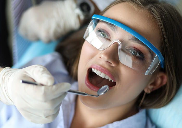 SD Dentist Checking Patient Teeth