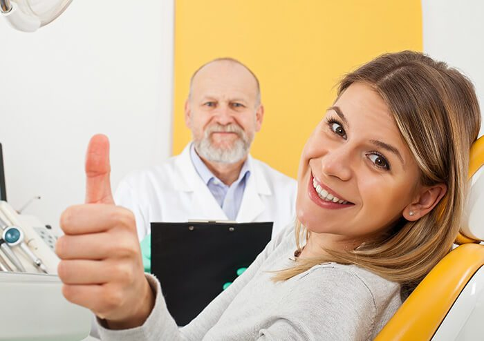 SD Woman with Beautiful Smile doing a Thumbs Up