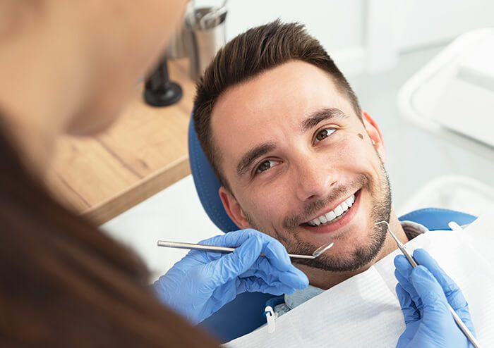 SD Patient Smiling at Dentist