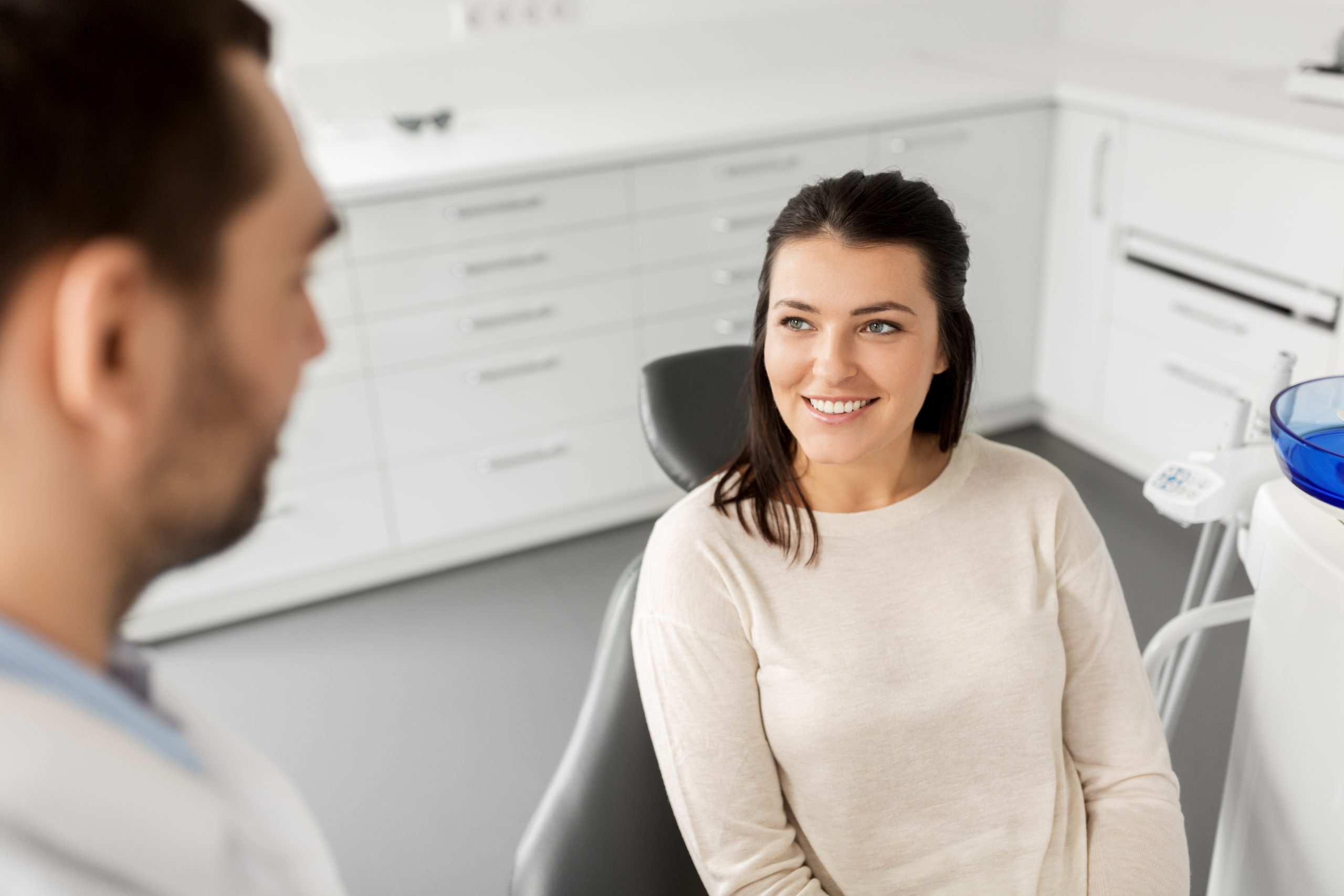 SD Woman smiling at her dentist