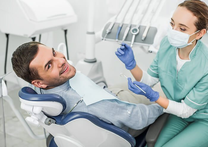 SD Patient Smiling as Dentist Prepares to check his teeth