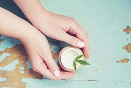 Hand holding a CBD for slim and muscle